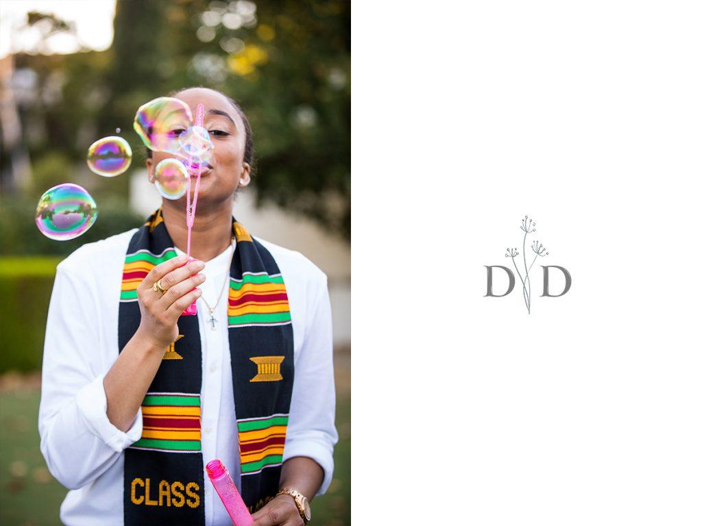 Grad Photo Blowing Bubbles