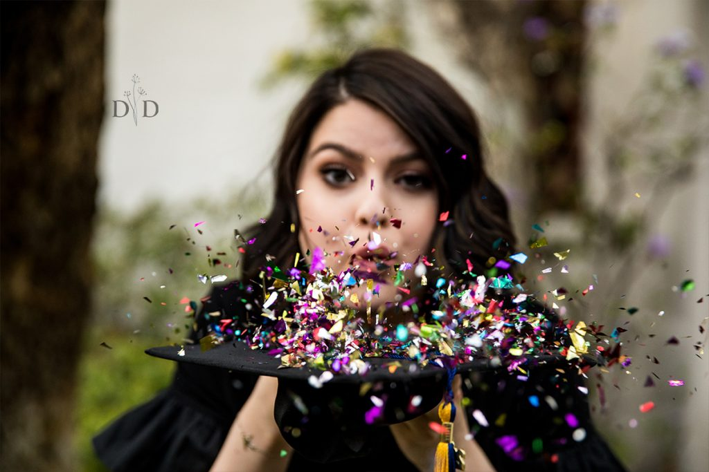 Blowing Confetti off Grad Cap